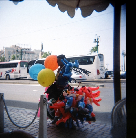 a child toy vendor in Alexandria - Moustafa, a boy no older than 12 was out on the street selling balloons and inflatable toys to more fortunate children celebrating Bairam